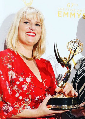 Marie Schley accepting an Emmy for her film costume designer work